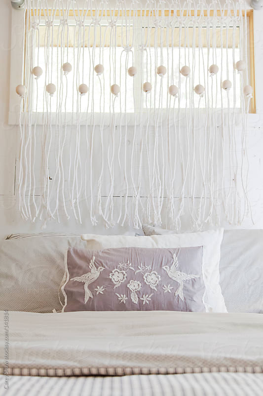 Detail of bed and bedroom by Carey Shaw for Stocksy United