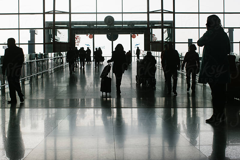 Silhouette of Anonymous Travelers in Airport by VISUALSPECTRUM for Stocksy United