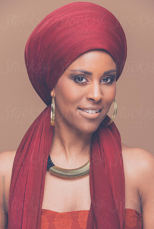 beautiful african woman wearing a traditional headwrap  by Andreas Gradin for Stocksy United