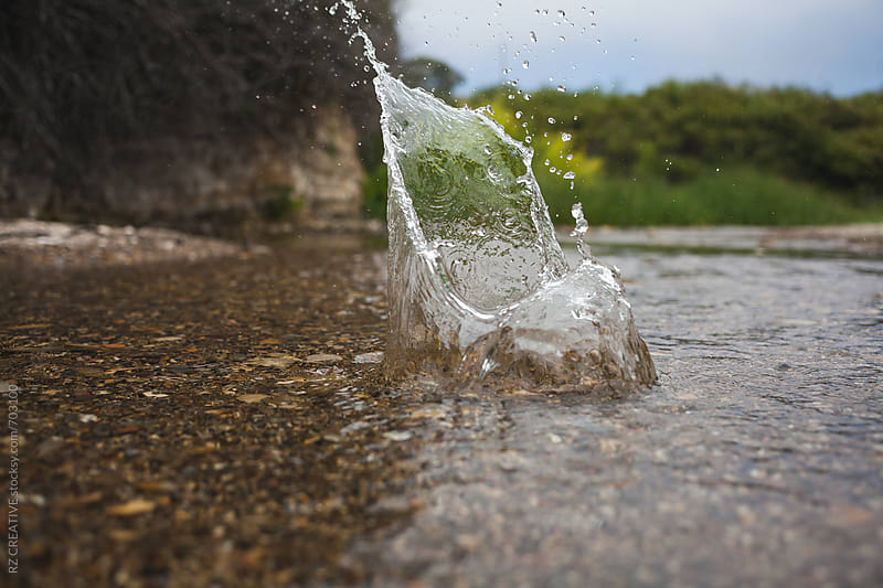Water splash in a small stream. by RZ CREATIVE for Stocksy United