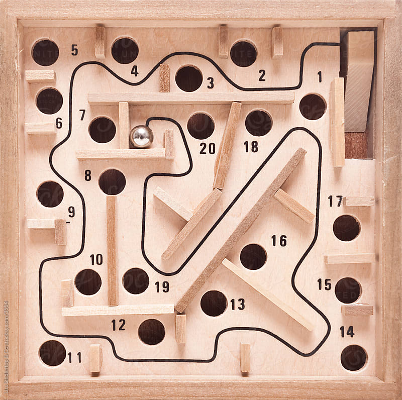 Wooden maze game with silver ball  by Urs Siedentop & Co for Stocksy United