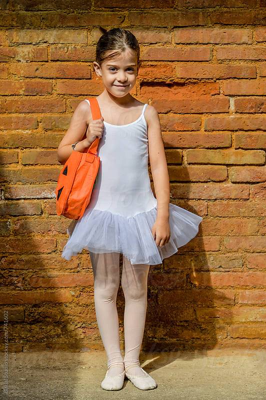 Little girl wearing a ballerina costume and a Halloween bag by Bisual Studio for Stocksy United