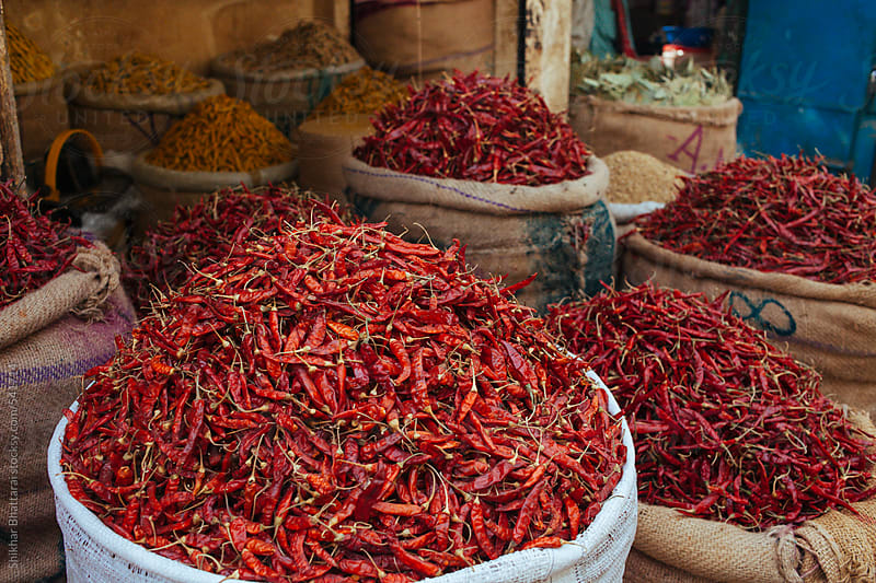 Heaps of red pepper and other spices for sale in a bazaar. by Shikhar Bhattarai for Stocksy United