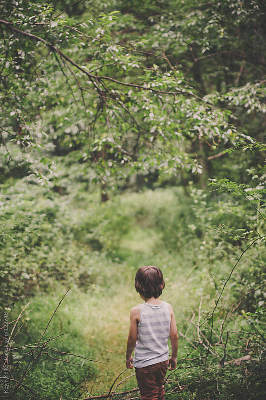 Young Boy Standing on a Hiking Trail by Kevin Keller for Stocksy United