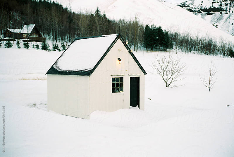 Hut in the snow by Sam Burton for Stocksy United