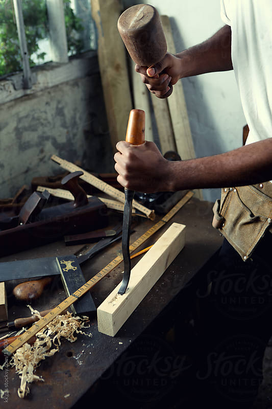 Carpenter chiselling. by kkgas for Stocksy United