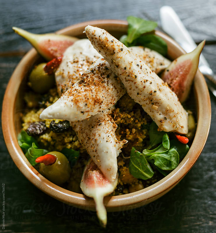 Chicken and couscous salad. by Darren Muir for Stocksy United
