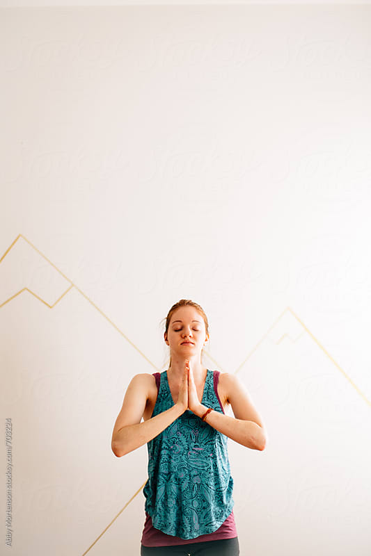 Yoga Woman in Prayer Pose by Abby Mortenson for Stocksy United