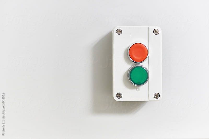 Electric on - off switch on a wall by Per Swantesson for Stocksy United