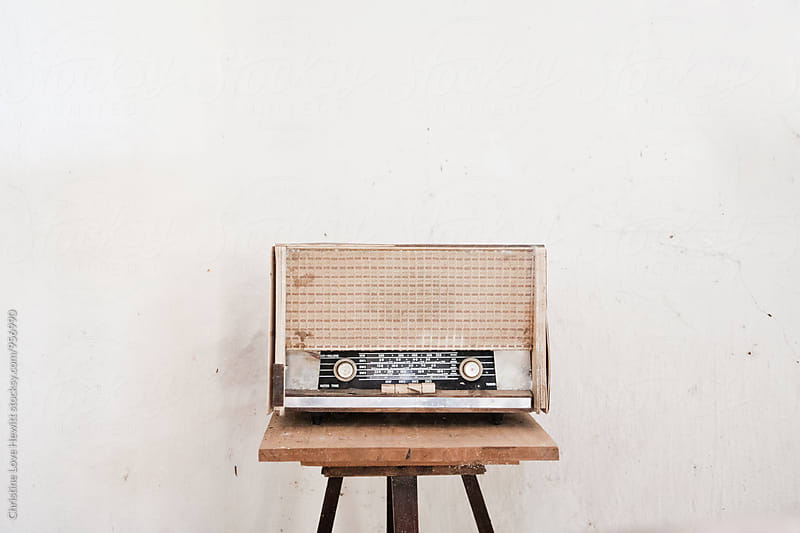 Old radio on a stool by Christine Hewitt for Stocksy United