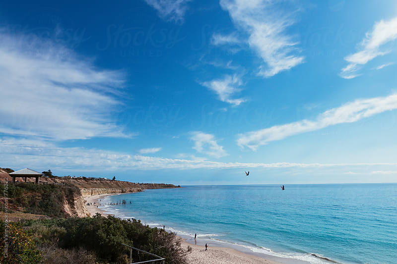 Port Willunga beach, on a beautiful sunny day. You can see the famous pier ruins. by Gillian Vann for Stocksy United