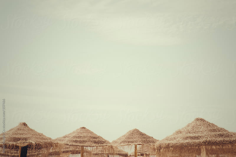 Umbrella tops on beach by Image Supply Co for Stocksy United
