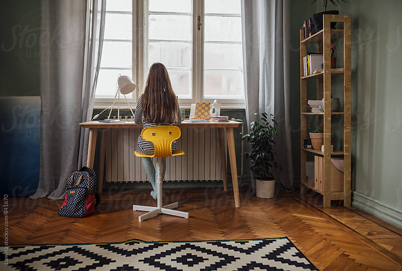 Girl Doing Homework at Home by Lumina for Stocksy United