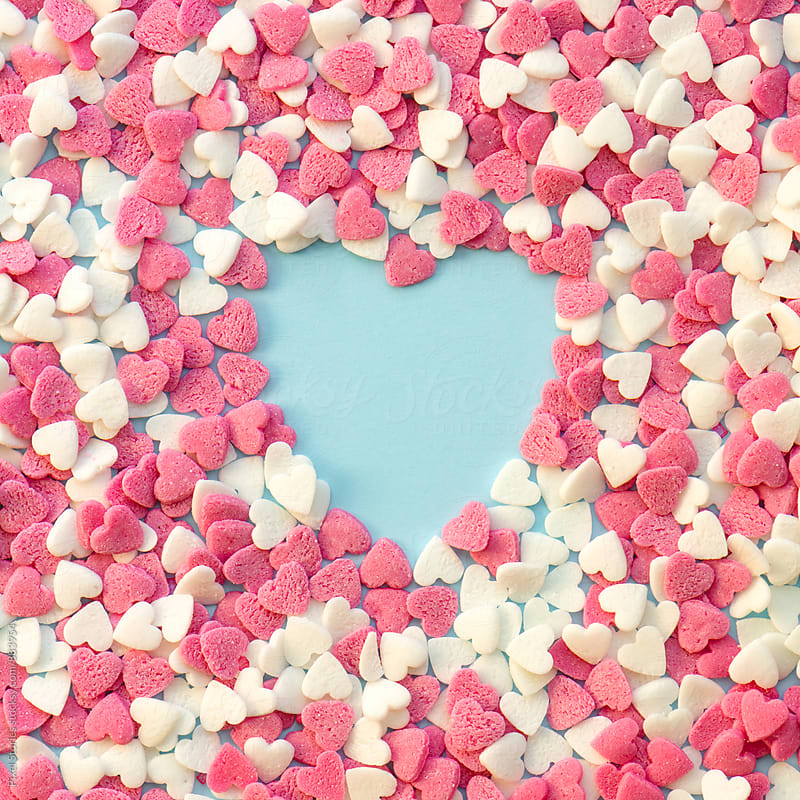 Heart made of heart-shaped nonpareils  by Pixel Stories for Stocksy United