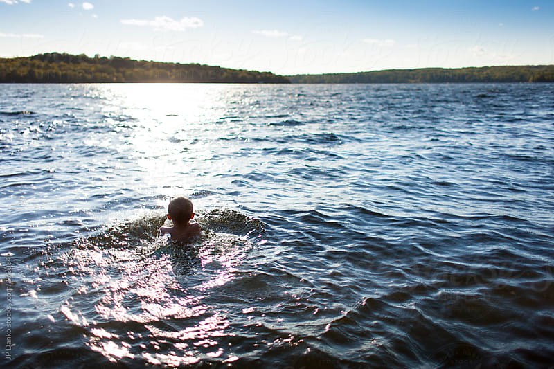Little Boy Swimming at Cottage Lake in Summer by JP Danko for Stocksy United