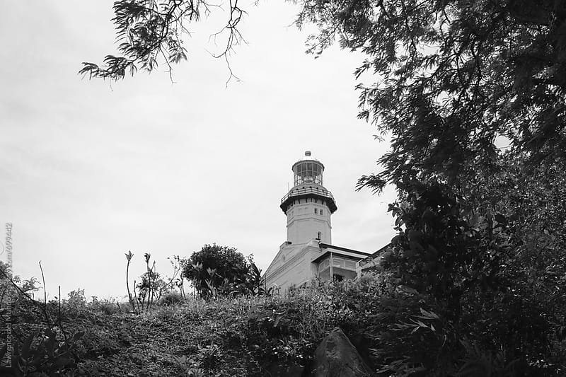 A century old Spanish era lighthouse on top of a hill by Lawrence del Mundo for Stocksy United