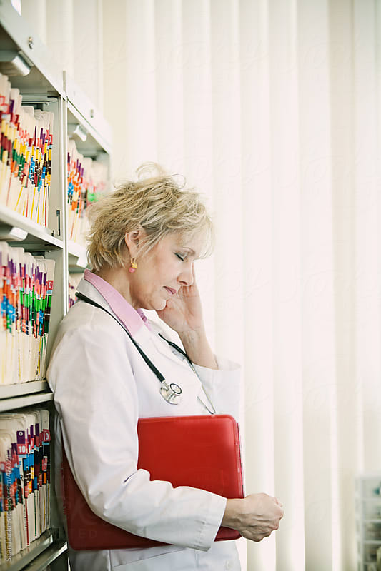 Waiting Room: Doctor Has Headache by Sean Locke for Stocksy United