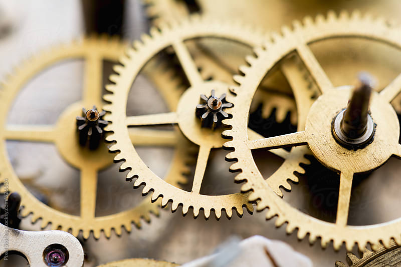 Clock gears close-up by Pixel Stories for Stocksy United