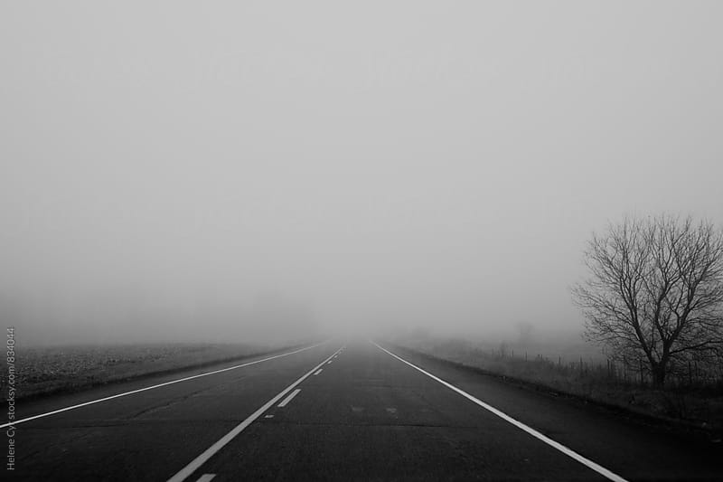 Fog on the road by Helene Cyr for Stocksy United