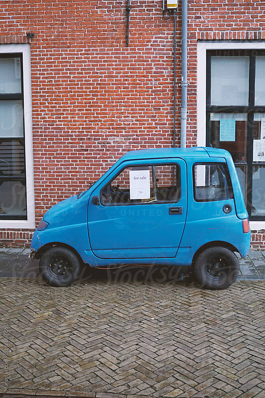 Tiny blue car for sale by Marcel for Stocksy United