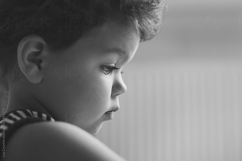 Profile of a concentrating toddler's face by Lea Csontos for Stocksy United