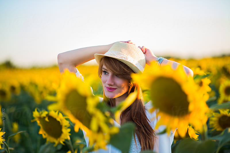 Beautiful Woman in a Sunflower Field by Mosuno for Stocksy United