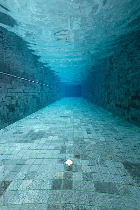 Empty swimming pool underwater by Jovana Milanko for Stocksy United