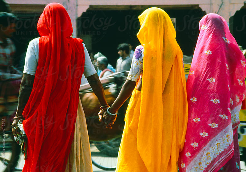 Women in colourful Saris in Jaipur, Rajasthan, India by Gavin Hellier for Stocksy United