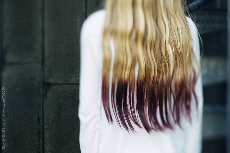 Purple dyed hair of a young blonde girl by Gabriel (Gabi) Bucataru for Stocksy United