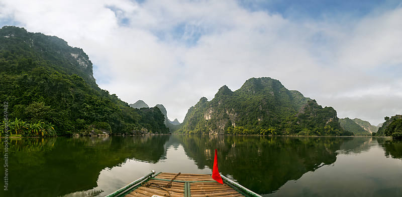 Paddle boat on a river in Vietnam by Matthew Smith for Stocksy United