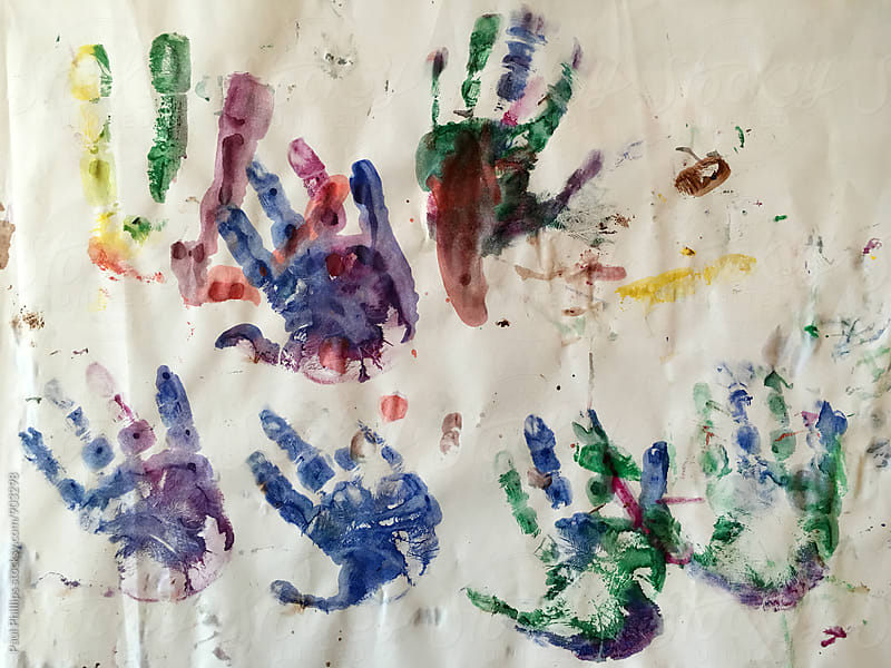 Hand prints on paper of a three year old child. by Paul Phillips for Stocksy United