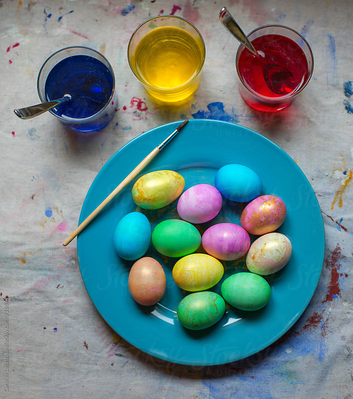 Plate of colorful dyed Easter eggs by Carolyn Lagattuta for Stocksy United