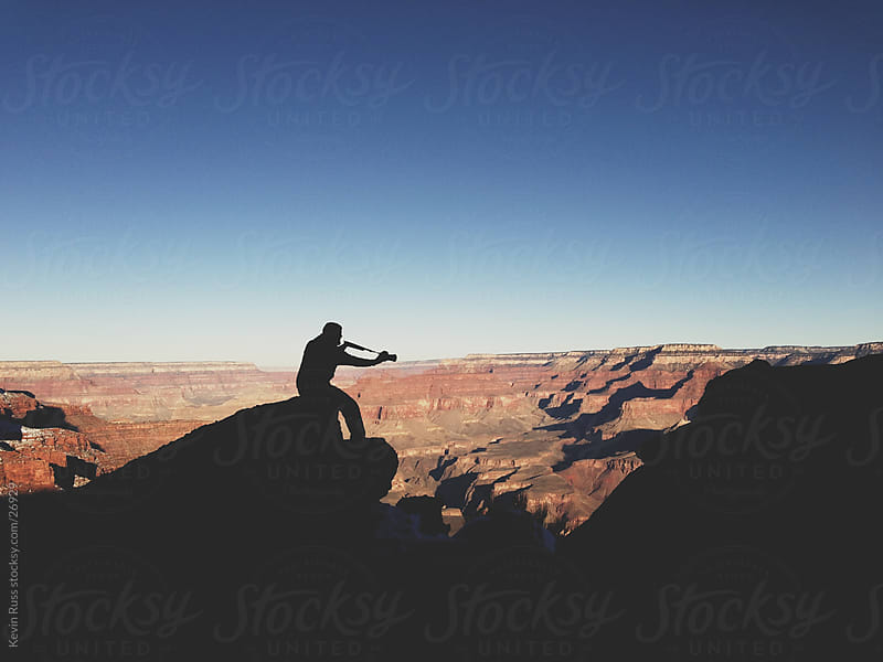 Grand Canyon Silhouette Shooter by Kevin Russ for Stocksy United