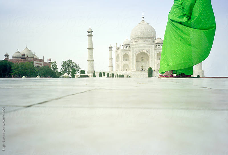 Indian woman in green sari, standing infront of the Taj Mahal. by Hugh Sitton for Stocksy United