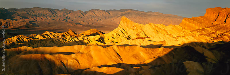 United States of America, California, Death Valley National Park, Zabriskie Point at sunrise, panoramic by Gavin Hellier for Stocksy United