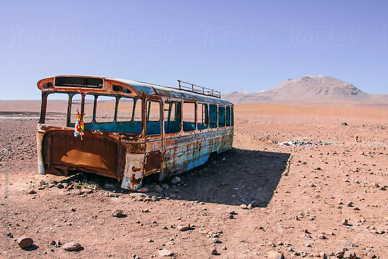 Rusty broken and abandoned bus on desert, Bolivia by Alejandro Moreno de Carlos for Stocksy United