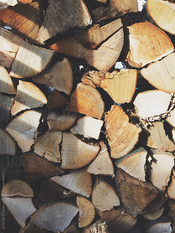 Close up image of packed and chopped firewood by Dimitrije Tanaskovic for Stocksy United