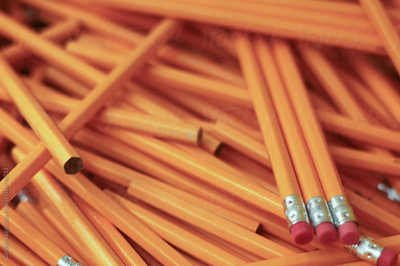 Many un-sharpened pencils in a bin by Carolyn Lagattuta for Stocksy United