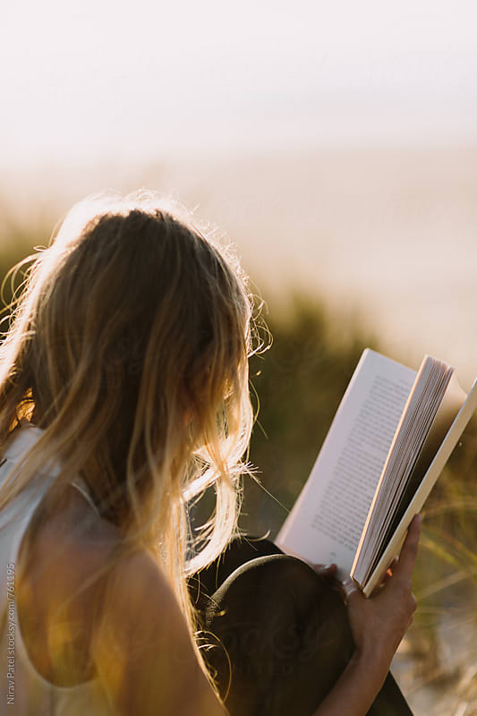 Reading at the beach.  by Nirav Patel for Stocksy United