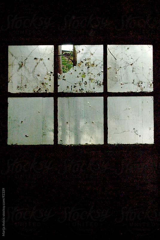 broken windows by Marija Anicic for Stocksy United