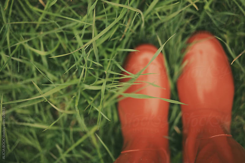 Red Boots In The Grass by ALICIA BOCK for Stocksy United