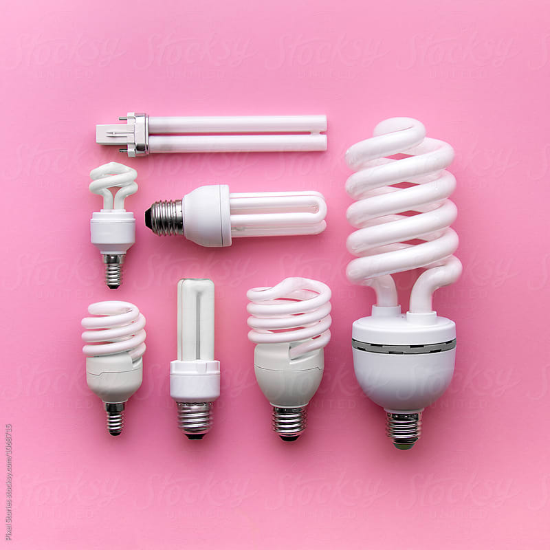 Energy-saving lightbulbs on pink background by Pixel Stories for Stocksy United