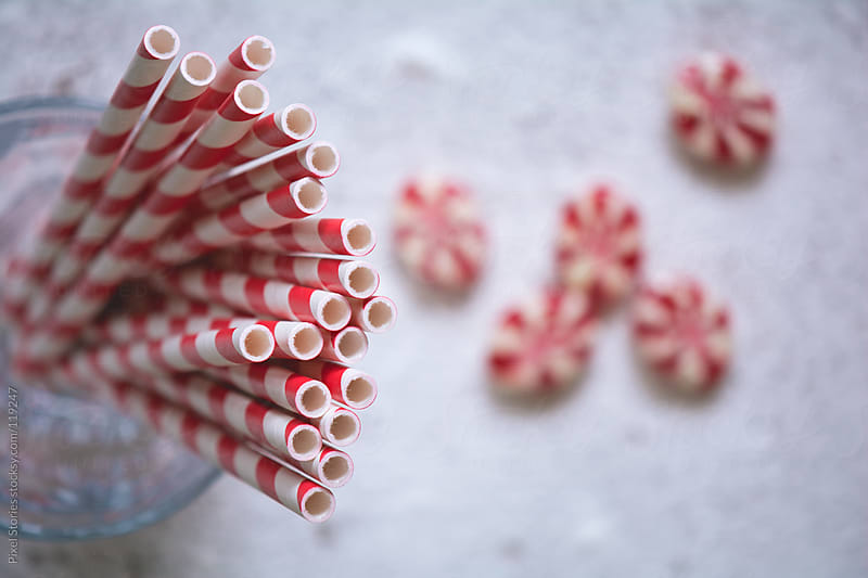 Red straws and candies by Pixel Stories for Stocksy United