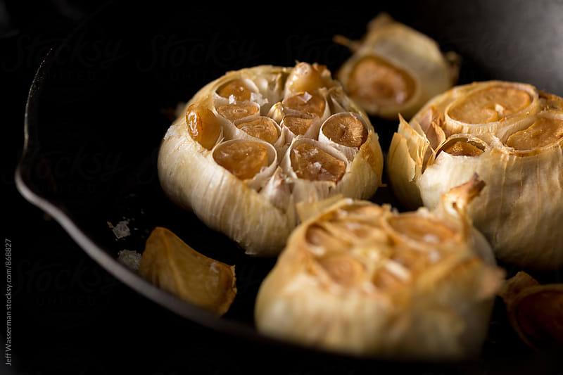 Roast Garlic in Cast Iron Pan by Jeff Wasserman for Stocksy United