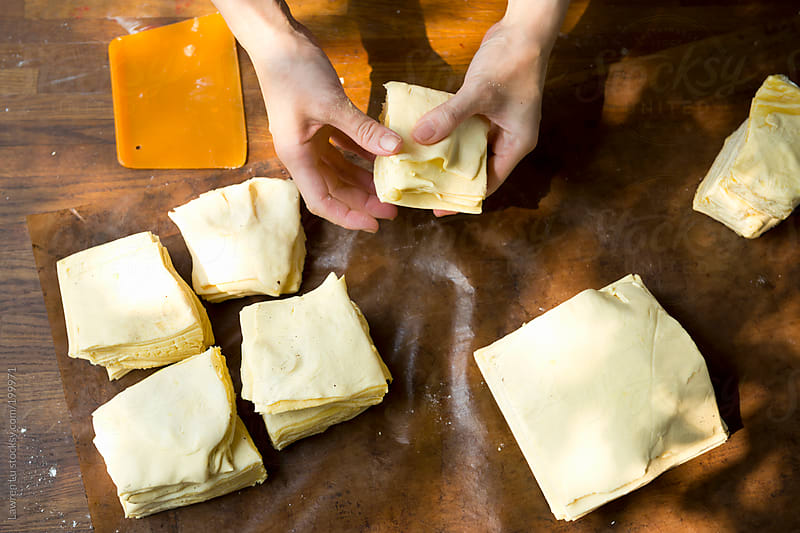 Woman hands putting butter in dough for making puff pastry by Lawren Lu for Stocksy United
