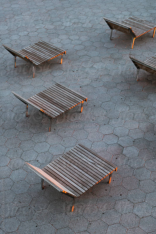 Wooden chairs at New York Port by Javier Márquez for Stocksy United