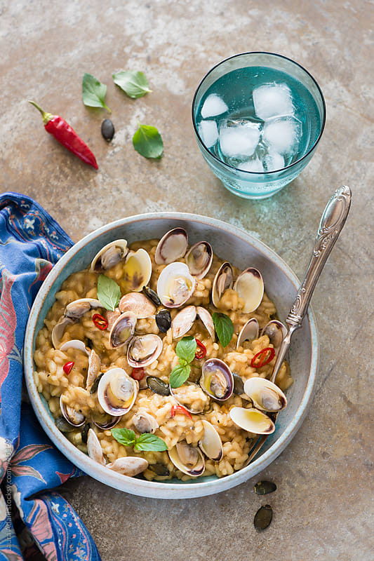 pumpkin risotto with clams by Laura Adani for Stocksy United