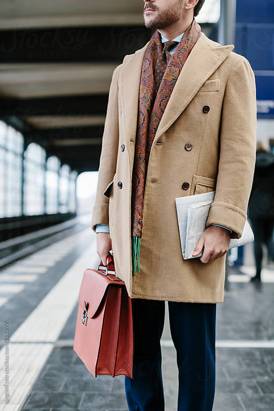 Businessman Waiting For His Train by VegterFoto for Stocksy United