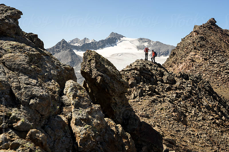 Two climbers taking a rest on a mountain ridge in the alps by Tristan Kwant for Stocksy United