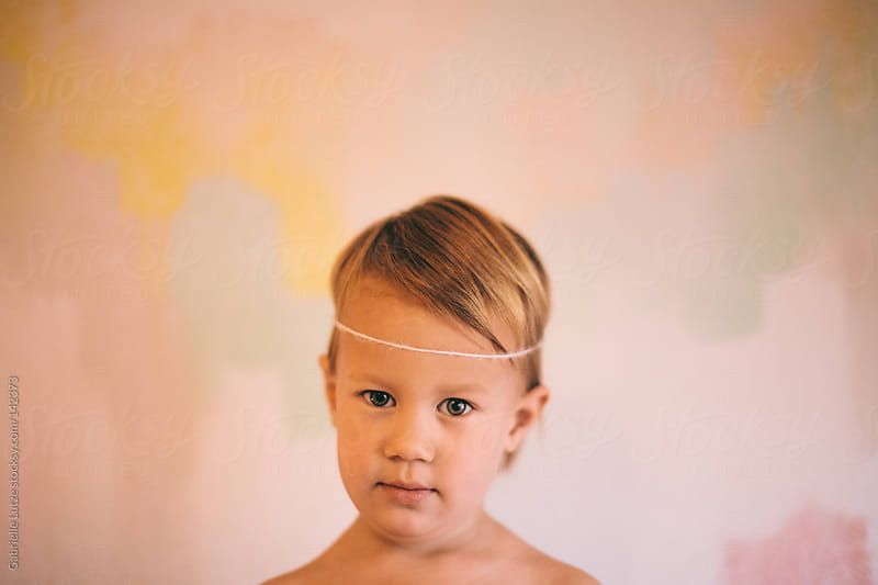 Little Girl in front of Painted Wall by Gabrielle Lutze for Stocksy United